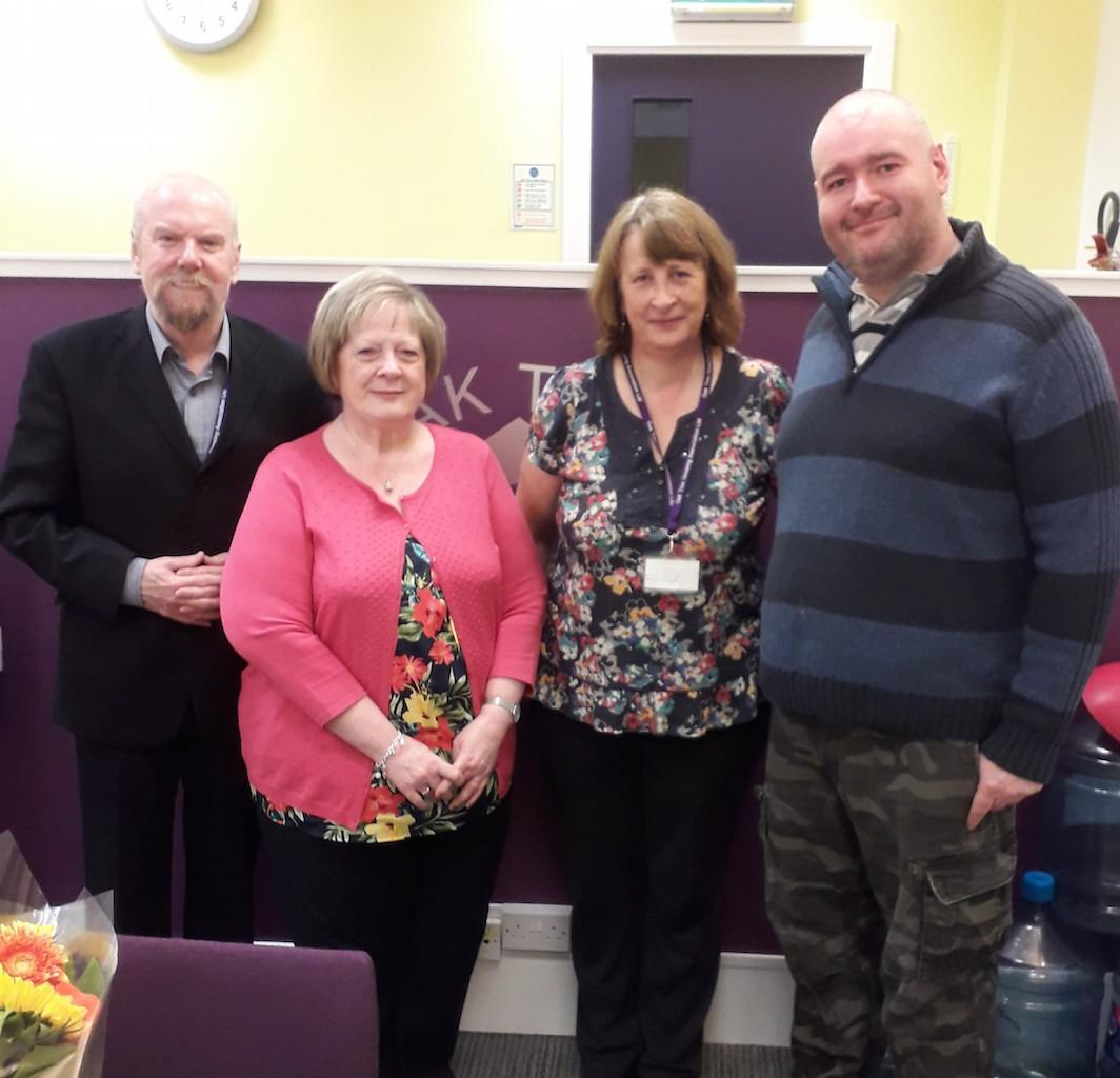 Nick Jardine (left) and Hazel Aitken (second right), are pictured with Anne McEachnie and John McDonagh during their visit to the Oak Tree Housing Association office.