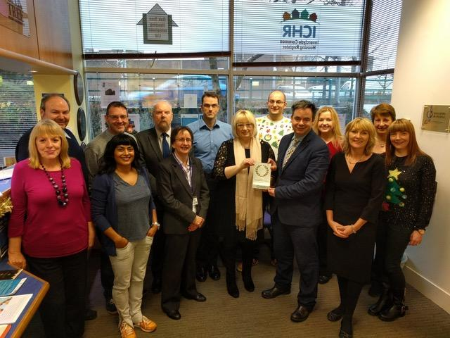 Staff and Committee receiving IIP Gold Award